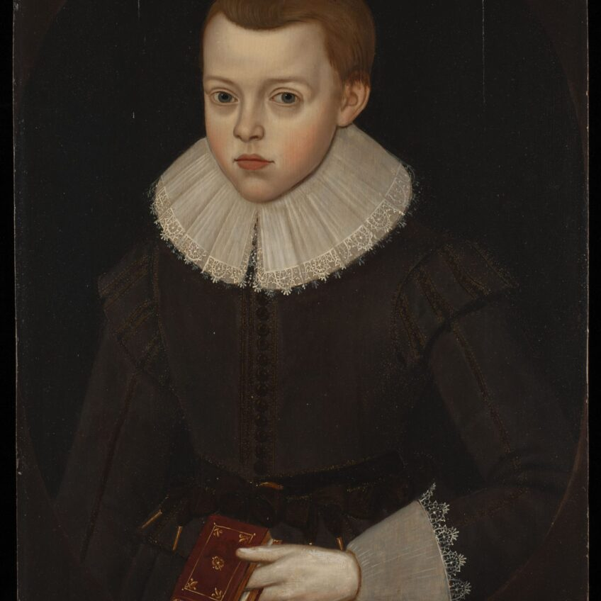 Front view, three-quarter length portrait of boy looking straight at us