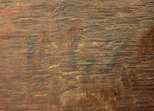 Detail of a number reading 167 on the back of a painting's panel support